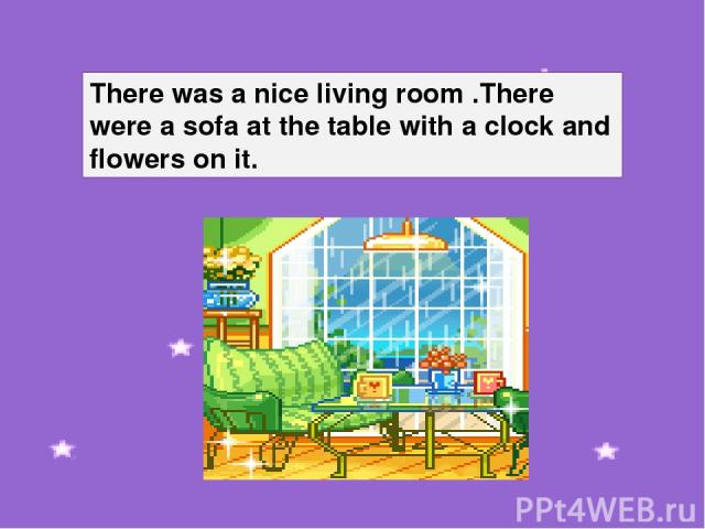 There was a nice living room .There were a sofa at the table with a clock and flowers on it.